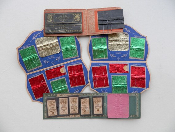Set of 4 Vintage Needle Books with Great Graphics