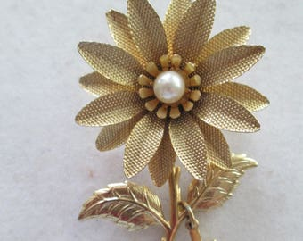 Gold Daisy Brooch pin with faux pearl accent in center with dangling religious cross