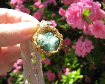 Romantic enchanted feathered birdnest on lace with turquoise eggs necklace