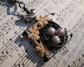 Woodland Birdnest in vintage watch case with lace necklace