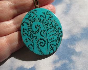 Fiddlehead Fern Art on verdigris oval vintage locket comes with brass chain