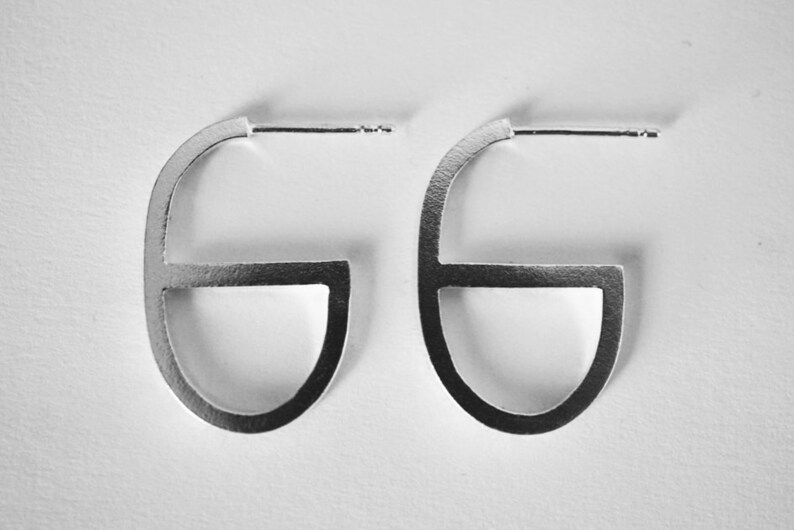 GG earrings  sterling silver or brass  pair image 0