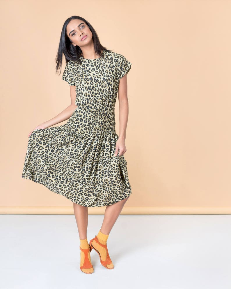 0e0e832cd3 ANIMAL PRINT MAXI dress vintage women flowy pleated skirt 90S | Etsy