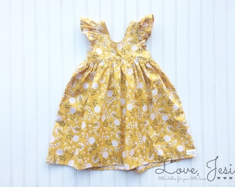 c52dbad12 Yellow baby dress
