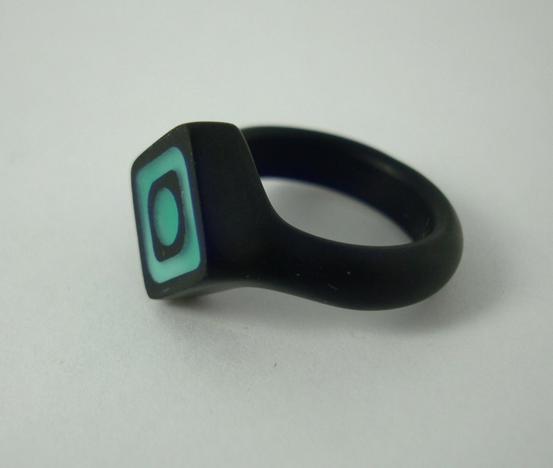 Resin ring with green offset squares. Size 6.5 image 0