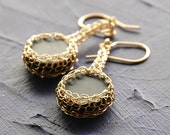 Earrings of Black onyx coins set in crocheted gold