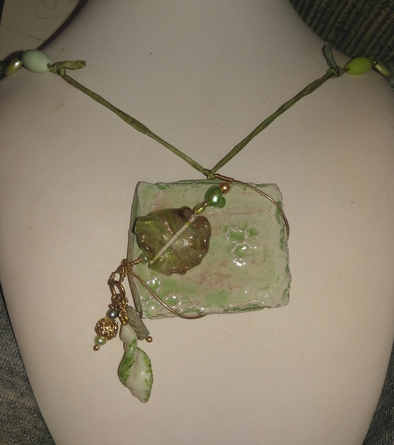 Pale Mint Green Wire Wrapped with Floral Bead Pendant on Satin image 0