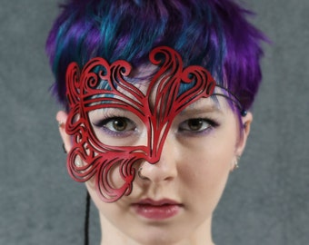 Bemused cut out leather mask in red