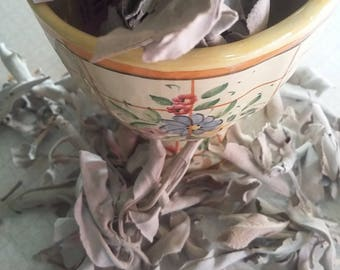 Sage, dried, fresh, steep in tea, ceremonial smudging, crush for cooking, smells woody when burned, used in mental healing