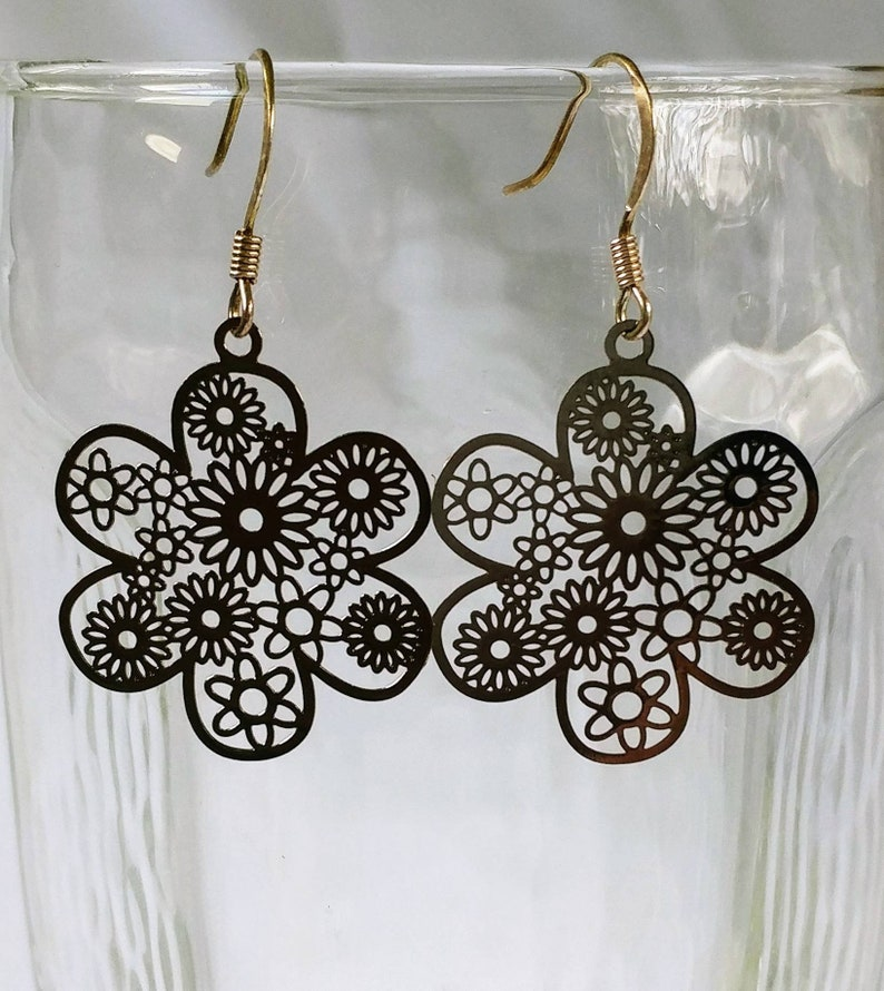 Laser Lace Flower Earrings in gunmetal that hang from French image 0