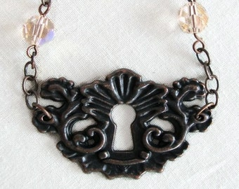 Francisca - antique copper keyhole and charm necklace - steampunk necklace - keyhole necklace