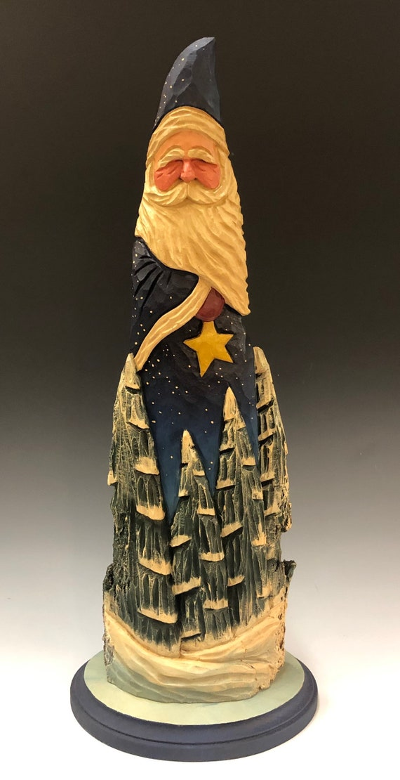 "HAND carved original 18"" tall Santa with star and trees on a base from 100 year old Cottonwood Bark."