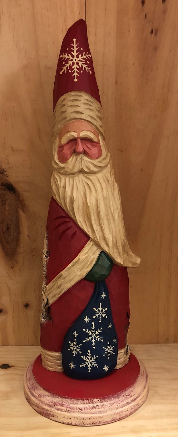 HAND carved original Santa with bag on a base from 100 year old Cottonwood Bark.