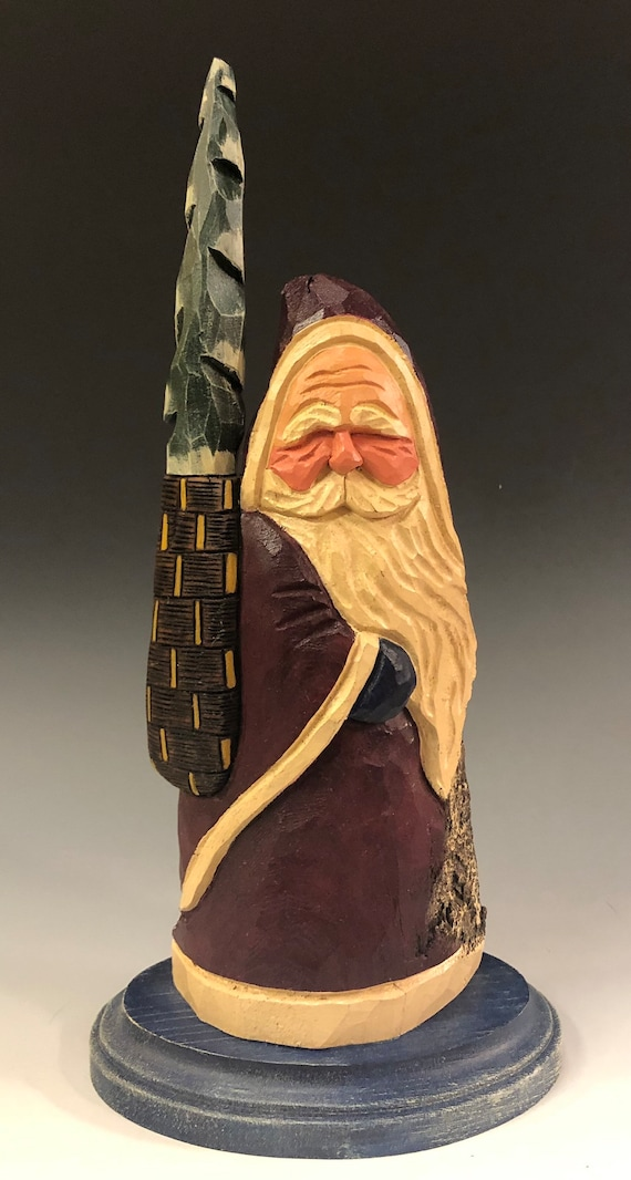 "HAND carved original 10.5"" tall Santa w/ tree in a basket on a base from 100 year old Cottonwood Bark."