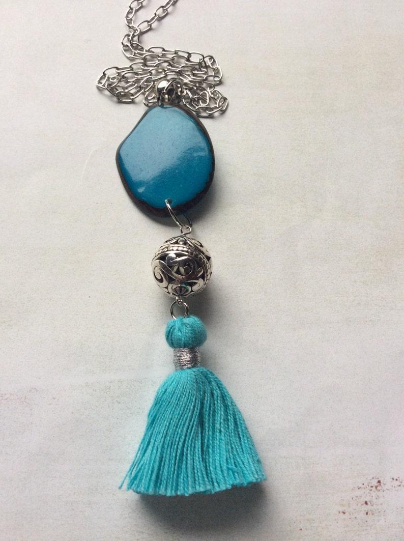 Tassel necklace Turquoise blue tagua nut cotton tassel.Silverplated filigree.