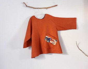 ready to wear plus size rust linen blouse with large off-kilter rounded pocket