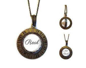 Real / Not Real SPINNER Brass Spin Pendant Necklace fortune teller