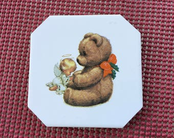 Ceramic Coasters With Teddy Bear Holding a Angel  it is 4 1/4 by 4 1/4