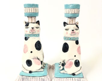 Cats with superiority complex set of ceramic candlesticks in pink and turquoise