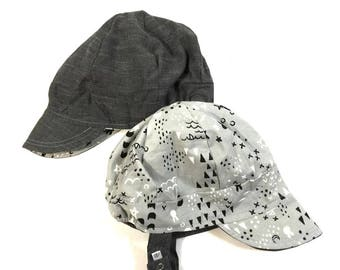 15b1da46011 UB2 XOXO a gray chambray reverses to fun geo shapes and animals on this  baby BOY newsboy sun hat