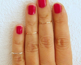 Above the knuckle rings, 3 stack midi rings