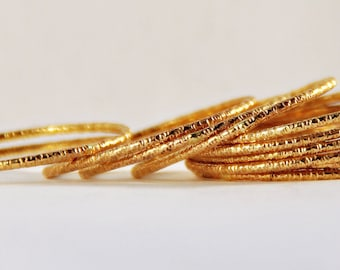 Catch the light: Unique set of 11 yellow gold filled skinny textured stacking rings- skinny gold stackable rings- simple gold stacking ring