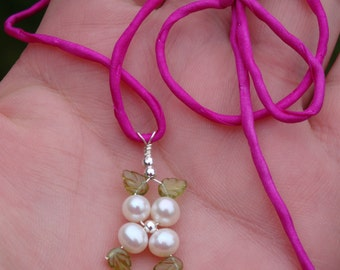 LOTUS BLOSSOM COLLECTION - myBouquet - Grade A White Pearls, Etched Peridot Leaves in Sterling Silver with 3 Silk Chords-Shown in Magenta