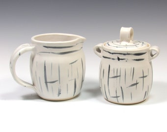 Black and White Pottery Sugar and Creamer Set