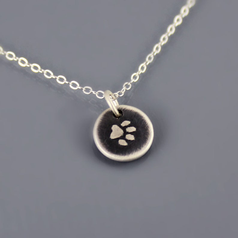 8b66649bf2911 Tiny Sterling Silver Paw Print Necklace