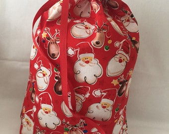 Christmas Fabric Gift Bag  Eco Friendly Bag  Drawstring Reuseable wrap --size 10 inches x 12 inches  Santa and Reindeer Fabric