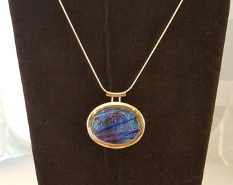 "Large silver pendant with beautiful dichroic glass insert. Necklace includes 17"" silver snake chain"