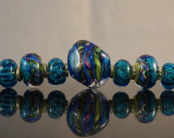 Set of 7  with 3 larger faceted. 4 accent beads.