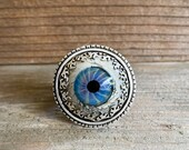 Glass eye statement ring in sterling silver, creepy cocktail ring