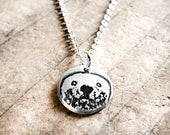 Tiny Sea Otter necklace in silver