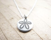Tiny sand dollar necklace in silver