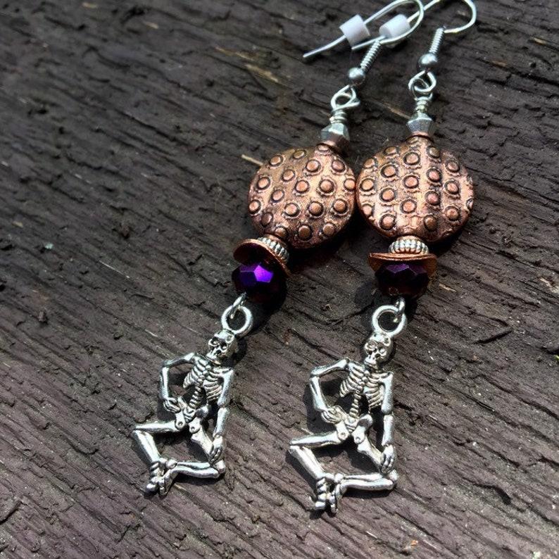 Halloween Skeletons In Purple And Copper Dangle Earrings image 0