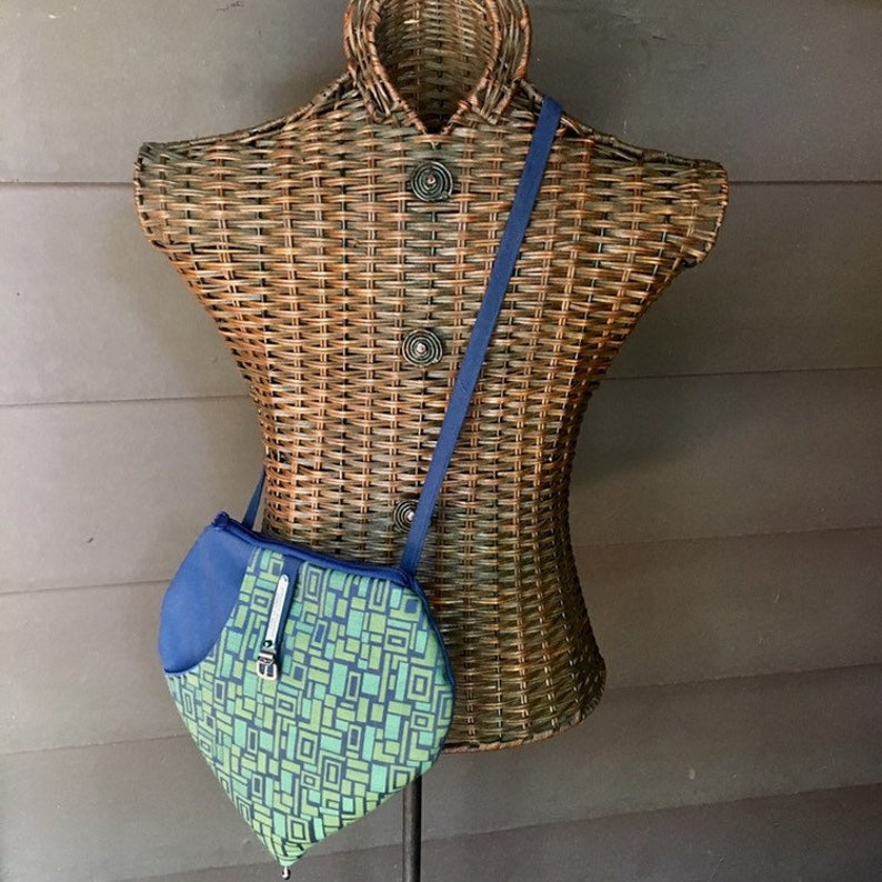 Zipper Top Steamlined Cross Body Purse in Blues And Greens. image 0