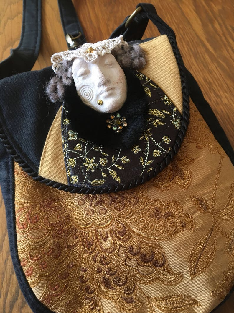 Tudor Maiden Round Purse Cross Body Strap image 0