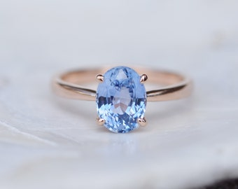 Blue sapphire engagement ring. Sky blue sapphire 2.14ct oval ring 14k Rose gold ring. Engagement ring by  Eidelprecious