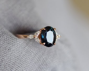 Green sapphire engagement ring. Peacock green sapphire 3ct oval diamond ring 14k Rose gold. Trillium Engagement ring by  Eidelprecious.