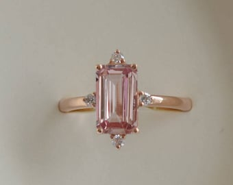 Baguette engagement ring. 1.65ct rectangular emerald cut Padparadscha sapphire 14k rose gold diamond ring. Engagement ring by Eidelprecious.