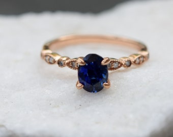 Rose gold sapphire ring. 1.2ct Royal blue sapphire diamond ring 14k rose gold oval engagement ring by Eidelprecious. Something Blue.