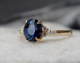 Navy blue sapphire engagement ring. Peacock blue green sapphire 1.8ct oval diamond ring 14k Yellow gold ring. Campari by  Eidelprecious.