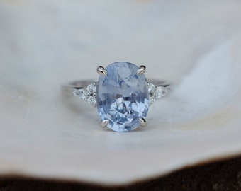 Arctic blue sapphire engagement ring. Color change sapphire ring 5.3ct oval diamond ring Platinum ring. Campari design by Eidelprecious
