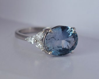 Platinum Storm Sea sapphire engagement ring. Color change sapphire ring 4.8ct oval diamond ring Platinum ring. Trillium ring Eidelprecious