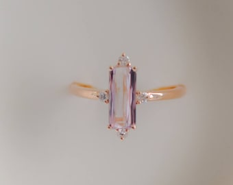 Baguette engagement ring. 1.25ct rectangular emerald cut Peach sapphire 14k rose gold diamond ring. Engagement ring by Eidelprecious.