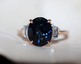 Jet Blue Ice Sapphire Engagement Ring. Rose gold ring. Diamond ring. Oval cut deep blue sapphire ring. Ice collection by Eidelprecious