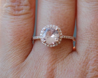 Rose gold diamond ring engagement ring with 2.3ct round peach sapphire. Diamond halo rings