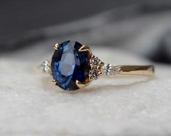 Navy blue sapphire engagement ring. Peacock blue green sapphire 2.8ct oval diamond ring 14k Yellow gold ring. Campari by  Eidelprecious.