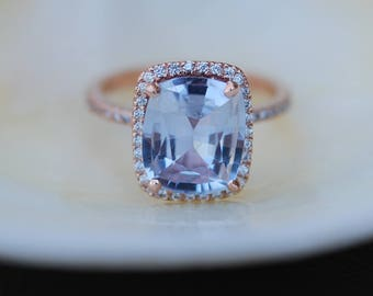 Blue sapphire engagement ring. 14k rose gold ring with certified 5.6ct cushion blue gray sapphire. Engagement ring by Eidelprecious